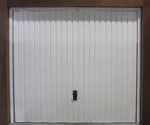 Porte de garage basculante sur mesure stores for Portes de garage basculantes